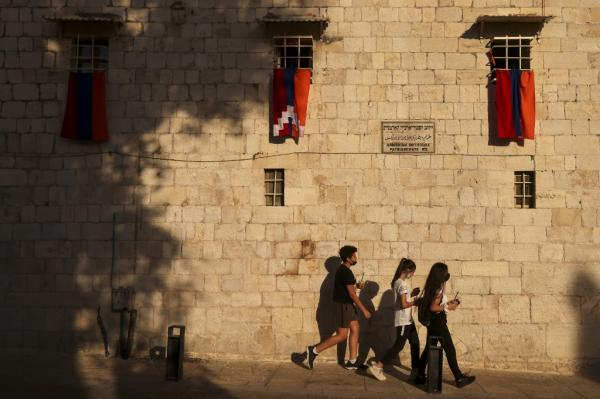 The Armenian and Nagorno-Karabakh flags sway in the wind in the old city of Jerusalem's Armenian quarter on October 7, 2020, as a display of support with the conflict in the Nagorno--Karabakh region Photo: Menahem Kahana/AFP