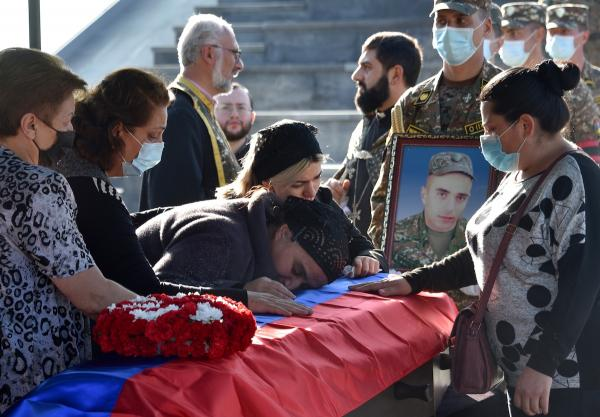 Relatives with the coffin of soldier Abraham Sargyan, who was killed in the fighting between Armenia and Azerbaijan over the breakaway region of Nagorno-Karabakh Photo: Karen Minasayan/AFP