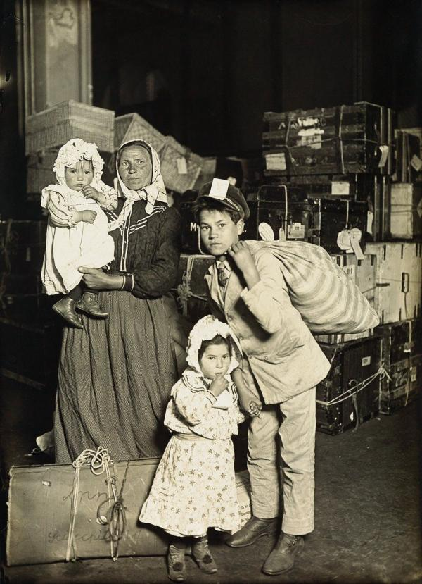 An Italian family arriving to 'the land of the free' at Ellis Island in 1905]