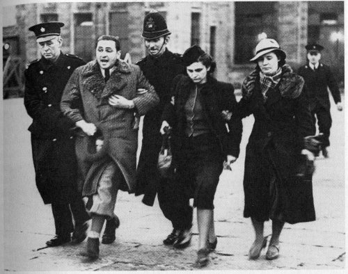Jewish refugees from Czechoslovakia being marched away by British police at Croydon airport ‎in March 1939‎