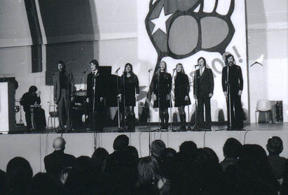 Chile solidarity concert in Helsinki in January 1974. On the stage the KOM Theatre Choir. Bald-headed President Kekkonen sitting in the first row left.