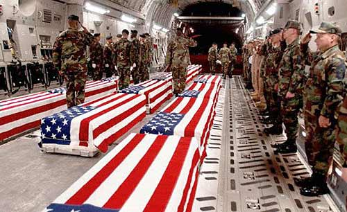 Caskets bearing U.S. soldiers are unloaded after a flight from the Middle East to Dover Air Force Base in Dover, Del.