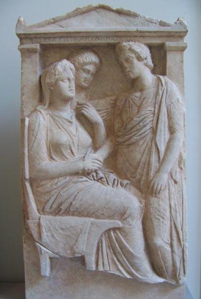 "Lysistrata and other Athenian women. Marble steele, 325-350 bC. The inscription reads Λυσιστράτη Παναθηναῖς, ""Lysistrata [talking] to all Athenian women""."